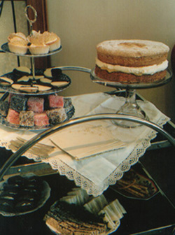 A stand filled with tea time cakes