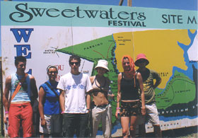 Festival goers in front of Sweetwaters sign